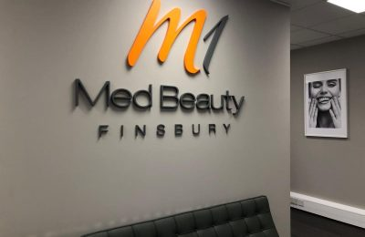 M1 Med Beauty Finsbury clinic 3D Logo on the wall.