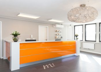 M1 Med Beauty clinic reception with orange counter and modern equipment